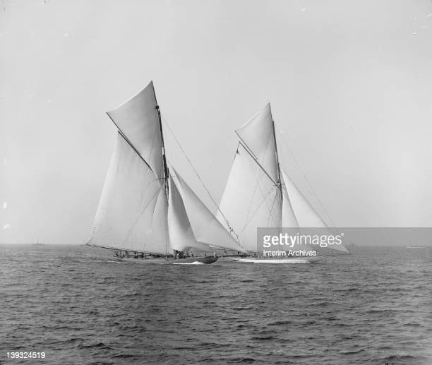View of Sir Thomas Lipton's Shamrock I and JP Morgan's yacht Columbia maneuvering for the start of the America's Cup race October 1899