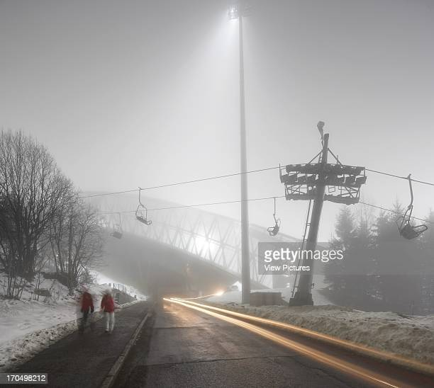 View of ski jump over road at night in the fog Holmenkollen Ski Jump Ski Jump Europe Norway JDS Architects