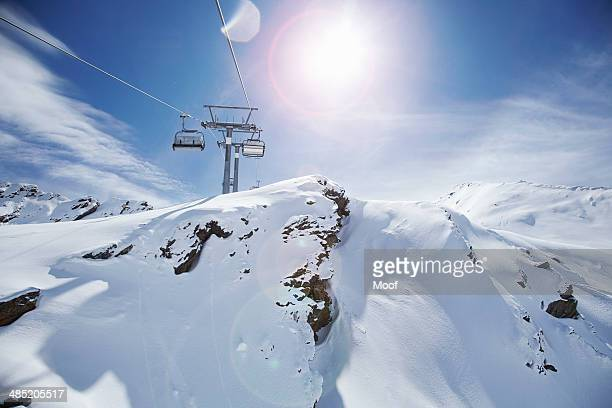 View of ski lift and snow covered mountains, Obergurgl, Austria