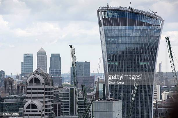 A view of skyscrapers at the Canary Wharf business financial and shopping district and 20 Fenchurch Street also known as the 'WalkieTalkie' right are...