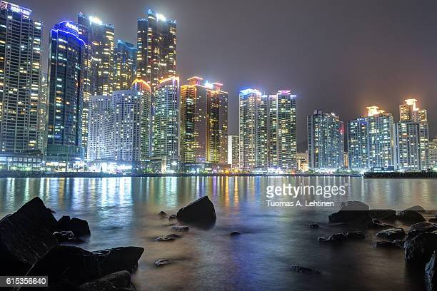 View of skyscrapers at the Marine City residential area in Haeundae District in Busan, South Korea, at night.