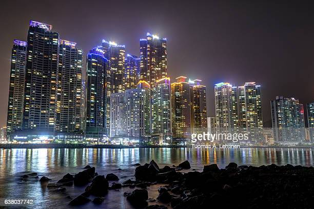 View of skyscrapers at the Marine City residential area in Haeundae waterfront district in Busan, South Korea, at night.