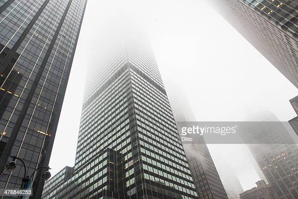 View of skyscrapers in mist, New York City, USA