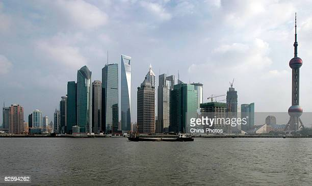 A view of skyscrapers in the Lujiazui Financial District including the Shanghai World Financial Center China's tallest building is seen on August 28...