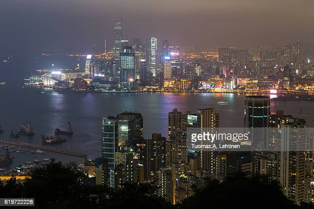 View of skyscrapers on Hong Kong Island and Kowloon at night