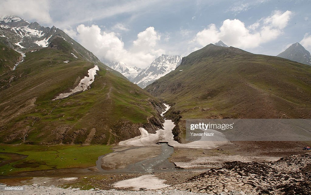 A view of snow covered glaciers along Srinagar-Leh highway near a treacherous pass on August 22, 2014 in Zojila, about 108 km (67 miles) east of Zojila, has an impressive location, enclosed by Kashmir valley on one side and Drass valley on the other side and functions as a major link between Ladakh and Kashmir, is considered to be the World's most dangerous pass is located at 3529 meters. The average snow buildup on the rocky Zojila- which is part of the 443 km (275 miles) long Srinagar-Leh highway- normally stays in the level of 15 to 25 meters and is closed for half year. It opens up in late spring and witnesses violent breezes because of the conical shape. Travellers on the pass have to face and withstand snowstorms, fierce air currents, cold and highly dangerous circumstances.