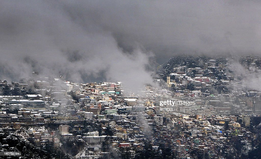 A view of snow-covered buildings in the town of Shimla, the capital of India's northern Himachal Pradesh state, on February 6, 2013. Heavy snowfall has left the town and many areas of the state without power and transport links, with reports of at least five people killed from an avalanche in the state's Kinnaur region. AFP PHOTO