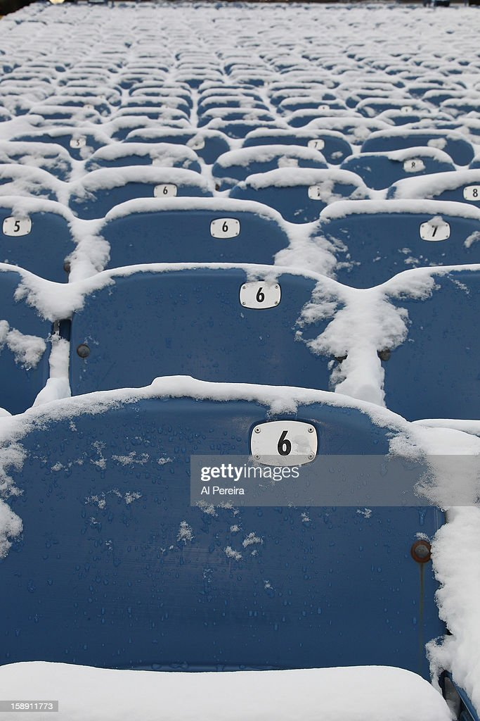 View of snow-covered seats before the game against the New York Jets and the Buffalo Bills when the Buffalo Bills host the New York Jets at Ralph Wilson Stadium on December 30, 2012 in Orchard Park, New York.