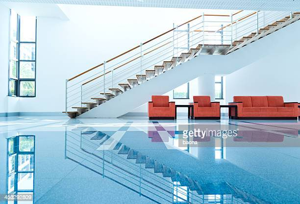 View of sofas and red chairs for people to rest on