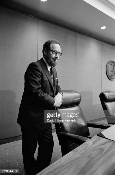 View of Solicitor General of the United States and acting US Attorney General Robert Bork as he leans on a chair at a press conference on Capitol...