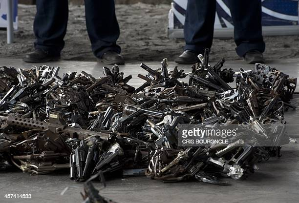 View of some of 3500 diverse firearms seized from criminal acts disarmament and amnesty programs before their melting at a foundry in Lima on...