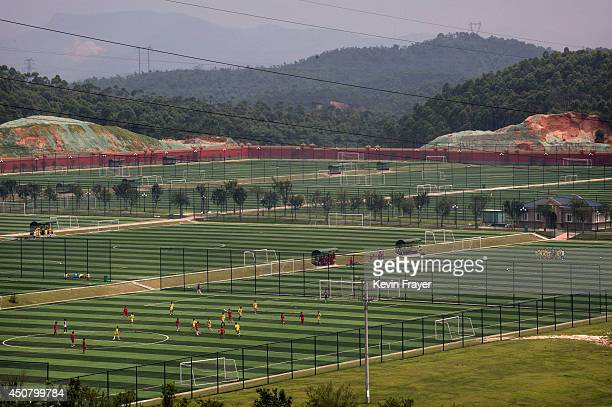 A view of some of the 50 pitches at the at the Evergrande International Football School on June 14 2014 near Qingyuan in Guangdong Province China The...