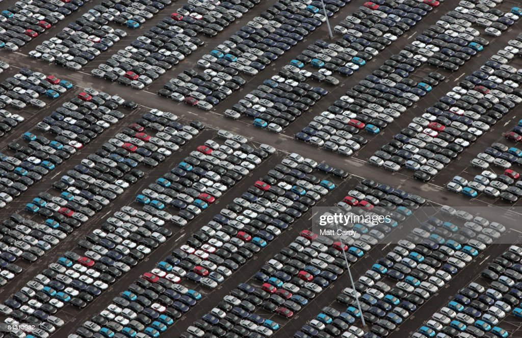A view of some of the thousands of unsold cars currently being stored at Avonmouth Docks on January 16, 2009 at Avonmouth, England. Sales of new cars in the UK have slumped to a 12-year-low and production of cars at Honda in Swindon has been halted for a unprecedented four-month period because of the collapse in global sales and represents the longest continuous halt in production at any UK car plant. The announcenent comes on a day when the EU's Industry Commissioner Guenter Verheugen warned the outlook for the European car industry was 'brutal' and predicted not all European manufacturers would survive the crisis.