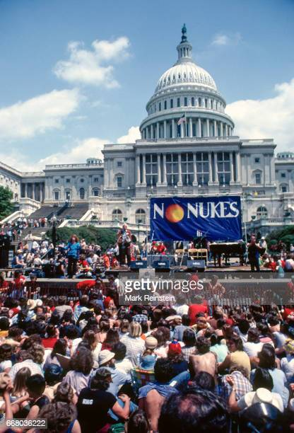 View of speakers and attendees as they attend a 'No Nukes' protest in the front of the west steps of the US Capitol Washington DC May 6 1979 The...