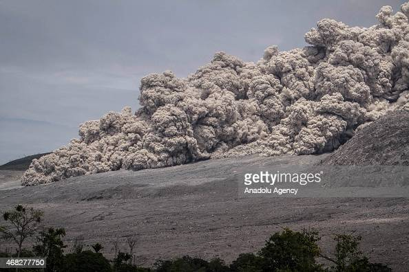 A view of spewing pyroclastic flow Mount Sinabung volcano is seen from Kuta Tengah village Karo North Sumatra Indonesia on April 1 2015 Indonesian...