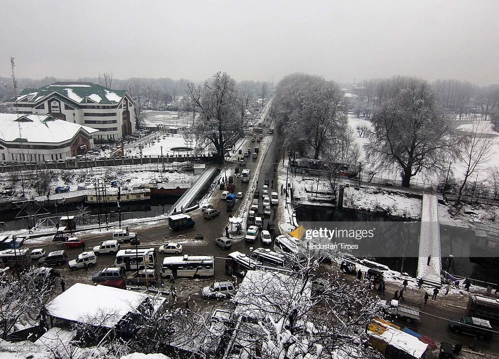 A view of Srinagar city during fresh Snowfall on February 23, 2013 in Srinagar, India. The Jammu-Srinagar National Highway remained closed for the second day on Saturday even as fresh snowfall across Kashmir prompted authorities to issue an avalanche warning in higher reaches of the Valley.