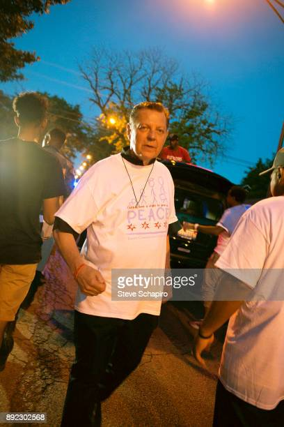 View of St Sabina Church's Father Michael Pfleger in a tshirt that reads 'Children have a right to grow up Peace' participates in a South...