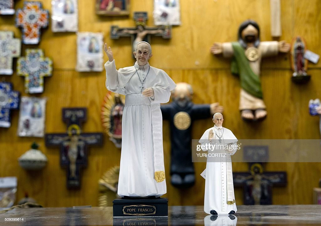 View of statuettes of Pope Francis for sale in an store near El Zocalo square in Mexico City on February 10, 2016. Pope Francis will visit four Mexican states from next February 12 to 17. AFP PHOTO / Yuri CORTEZ / AFP / YURI CORTEZ