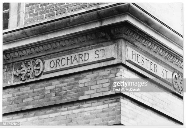 View of stone street signs on the northeast corner of Orchard and Hester streets New York New York May 17 1974