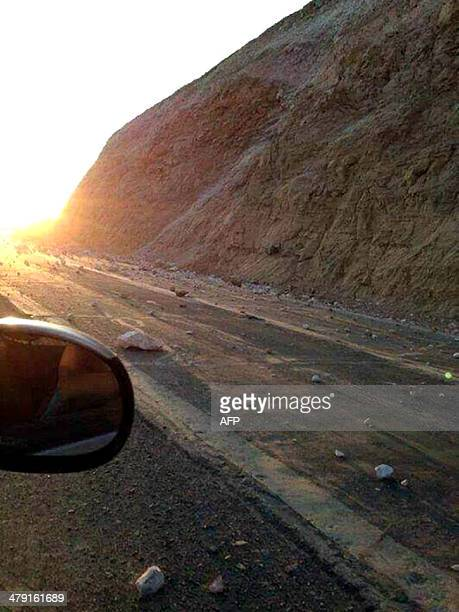 View of stones on the road after a quake in Iquique 1800 km north of Santiago Chile on March 16 2014 A powerful magnitude 70 earthquake jolted...