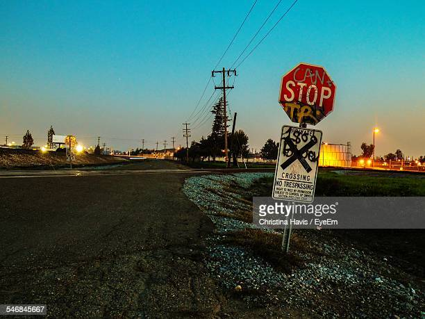 View Of Stop Signboard Along Empty Road
