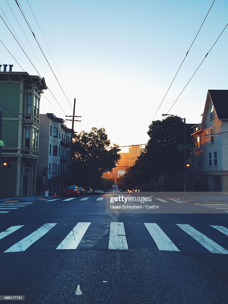 View of street in town at sunset