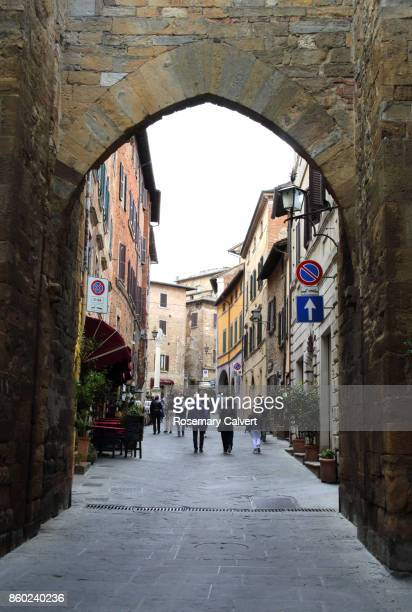 View of street through portal in city wall, Montepulciano.