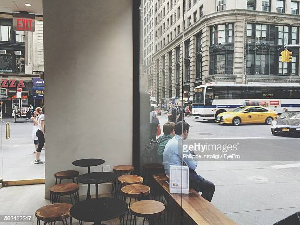 View Of Street Through Window In Cafe