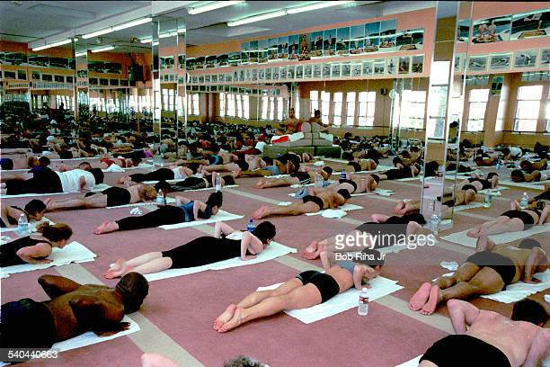 View of students during a yoga class in heated room Beverly Hills California February 2 2000 Indian Yoga guru Bikram Choudhury instructs the class...