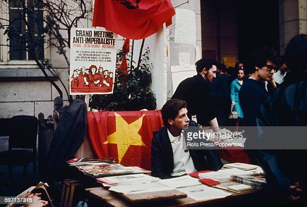 View of students of the Sorbonne University of Paris sitting at stalls containing communist pamphlets literature posters and magazines along with a...