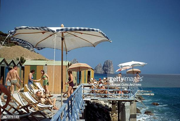 A view of sun bathers on a deck over looking the Gulf of Naples in Capri Italy