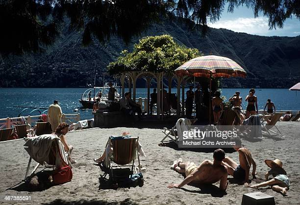 A view of sunbathers and boaters on Lake Como in Lombardy Italy
