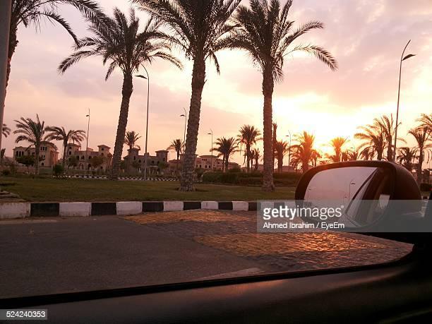 View of Sunset Through Car Window On Road