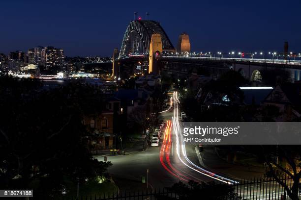 A view of Sydney's iconic landmark Harbour Bridge is seen after sunset on July 19 2017 / AFP PHOTO / SAEED KHAN