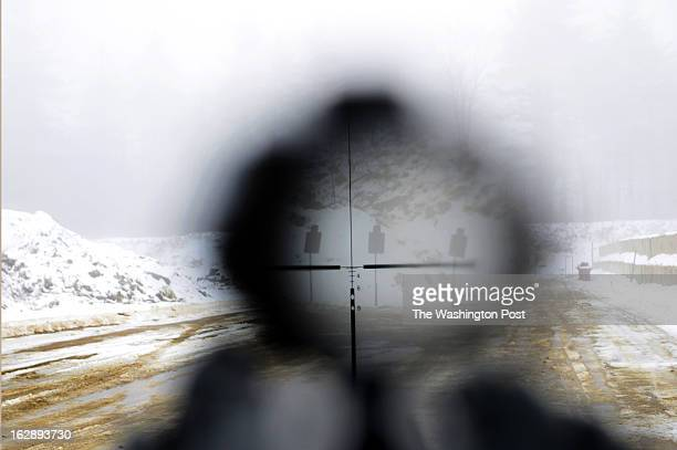 View of targets through a scope being used to sight in a gun at the SIG Sauer Academy in Exeter NH on January 30 2013 The company has a pro shop and...