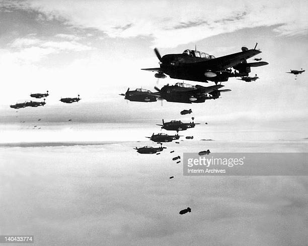 View of TBM Avengers and Curtiss SB2C Helldivers from the aircraft carrier USS Essex as they drop bombs on Hokadate Japan July 1945