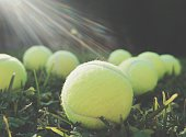 View Of Tennis Balls In Grass