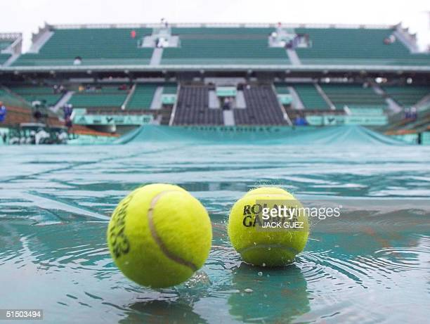 View of tennis balls on the covered Roland Garros central court 30 May 2000 at the French Open in Paris Persistent morning rain delayed the start of...