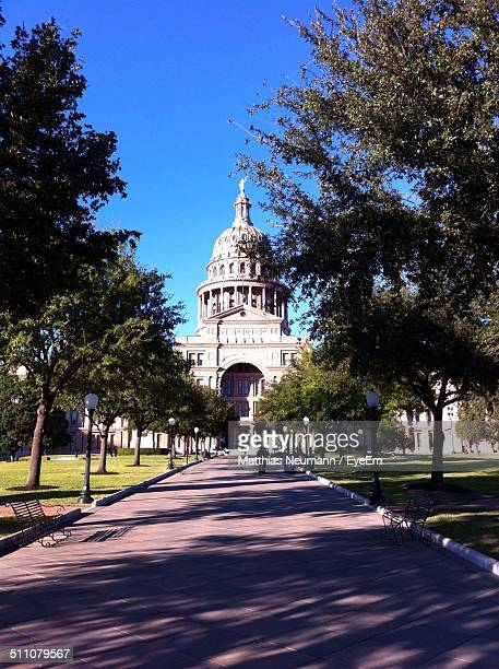 View of Texas State Capitol building against blue sky