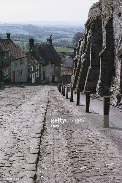 A view of thatched cottages and the cobbles of Gold Hill in rural Shaftesbury which runs steeply down Blackmoor Vale Dorset May 1970 Many of the...