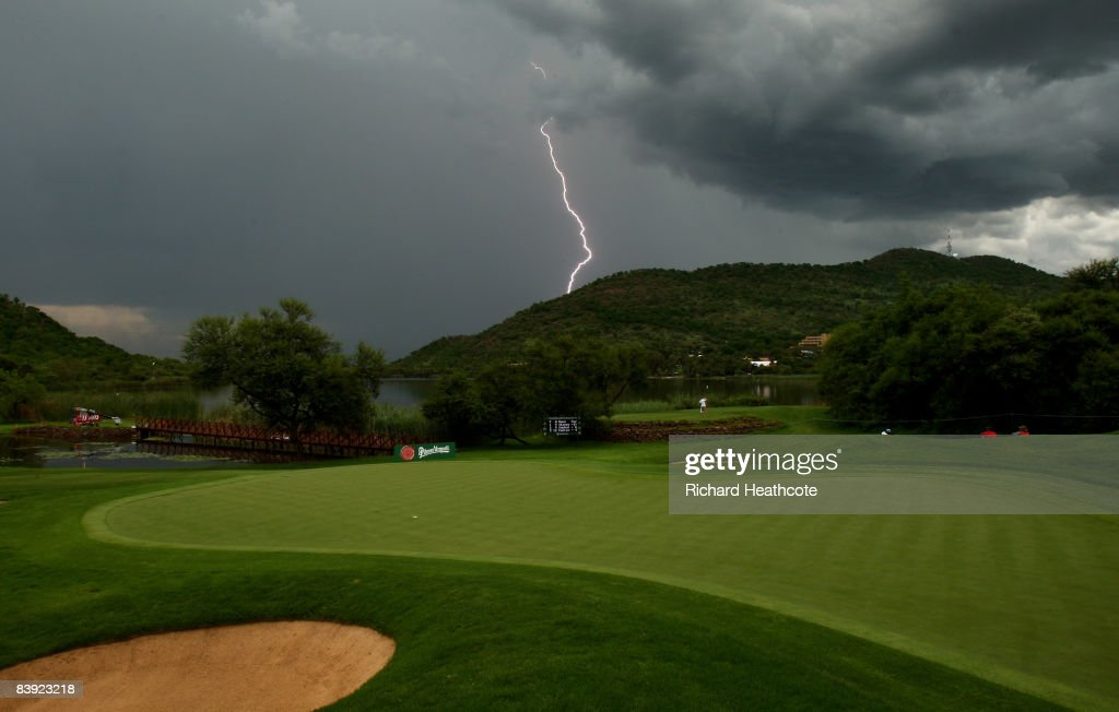 A view of the 16th green as lightning strikes the hills behind and storms bring a halt to play during the second round of the Nedbank Golf Challenge...