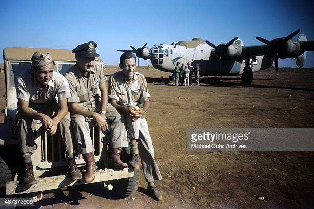 A view of the 389th Bombardment crew members pose by a B24 Liberator at the US Air Force base in Benghazi Libya