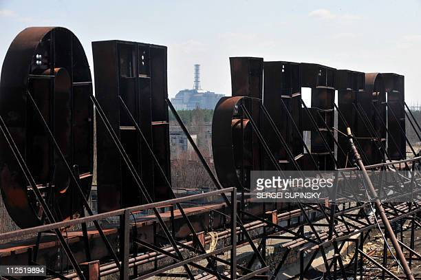 A view of the 4th power block of the Chernobyl Nuclear Power Plant taken from the roof of the Polesye hotel in the ghost city of Pripyat on April 18...