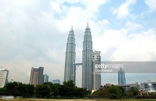 View of the 88story Petronas Twin Towers the tallest buildings in the world in downtown Kuala Lumpur Malaysia March 12 2002 The towers inspired by...