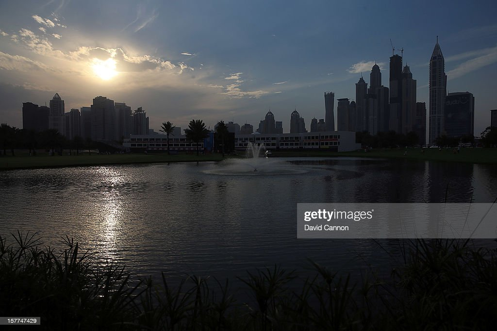 A view of the 9th and 18th holes with the skyline of Dubai Marina behind as the sun sets during the second round of the 2012 Omega Dubai Ladies Masters on the Majilis Course at the Emirates Golf Club on December 6, 2012 in Dubai, United Arab Emirates.