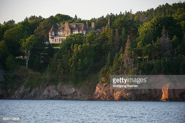 View of the Alexander Graham Bell estate and house from Bras d'Or Lake near Baddeck Nova Scotia Canada