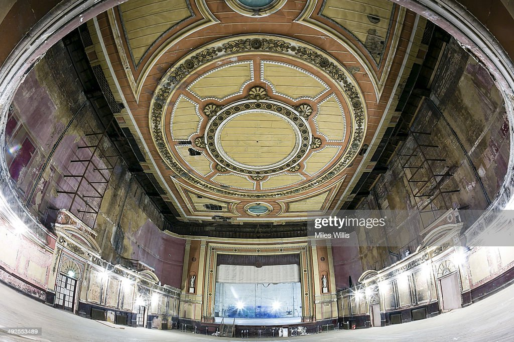 View of the Alexandra Palace Theatre auditorium looking towards the stage on May 16, 2014 in London, England. Alexandra Palace situated in the London Borough of Haringey First opened as 'The People's Palace' in 1873. Just 16 days later a fire broke out in the Palace, burning it down in its entirety. On 2 November the world's first regular high-definition public television broadcast took place from the BBC studios at Alexandra Palace. In 1980 fire again burned a large part of the building, the Palace reopened in 1988. Recently awarded a Round 1 pass from The Heritage Lottery Fund the Palace plans to renovate parts of the derelict building including the BBC Studios and Victorian Theatre.