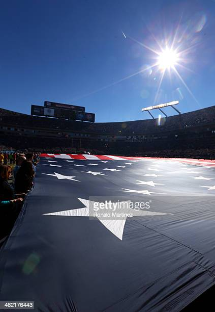 A view of the American flag as the National Anthem is played during the NFC Divisional Playoff Game between the San Francisco 49ers and Carolina...
