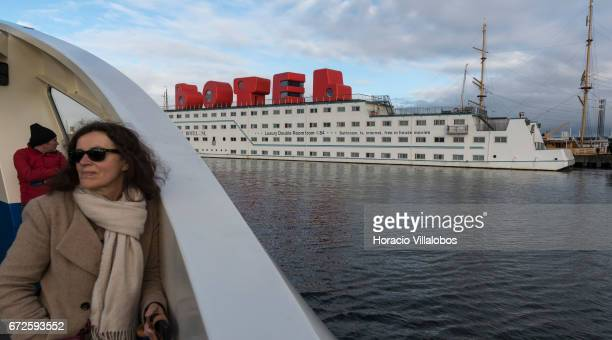 View of the Amstel Botel from the ferry sailing between NDSM Pier and Central Station on April 23 2017 in Amsterdam Netherlands Amstel Botel is a...