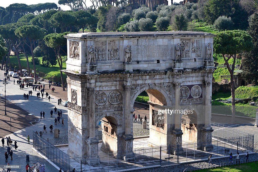 A view of the Arch of Constantine taken from the Colosseum on January 18, 2013 in Rome. Traces of decorations in blue, red and greenwere found in a corridor currently closed to the public while archaeologists were working to restore an area between the second and third floor of the Colosseum, which has fallen into disrepair in recent years.